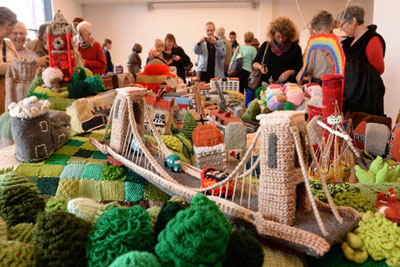 Image of the Bristol Suspension bridge all knitted in different coloured wools.