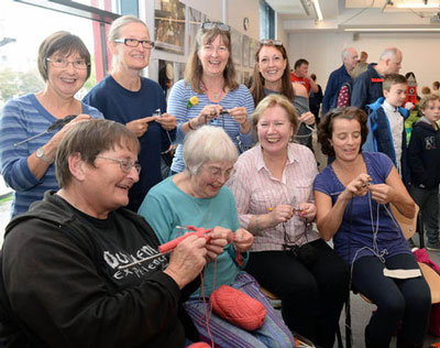 Image happy women sitting and knitting at the Briswool event.