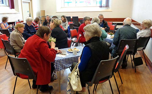 Image of people having refreshments at the Christian aid coffee morning.