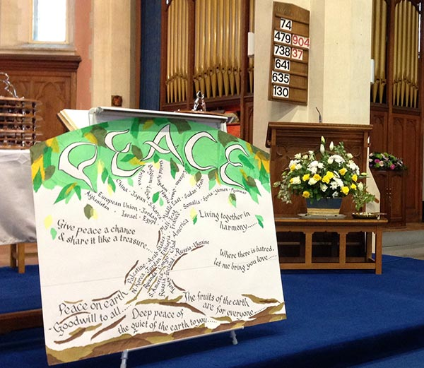 Peace board at the front of the church